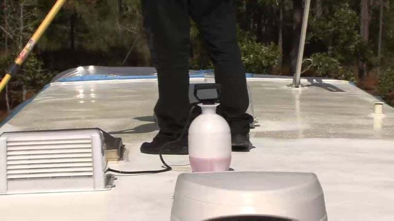 Cleaning RV roof with protectant