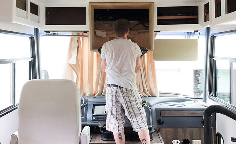 Man Installing TV In RV