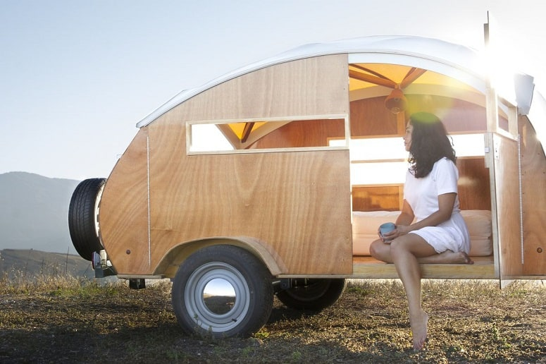 Woman Sitting In Teardrop Trailer