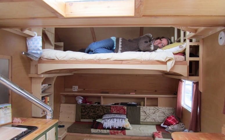 Woman Sleeping On Bunk Bed