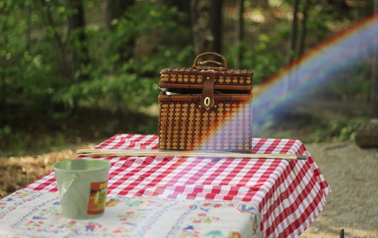 Basket And Cup On Table In Nature