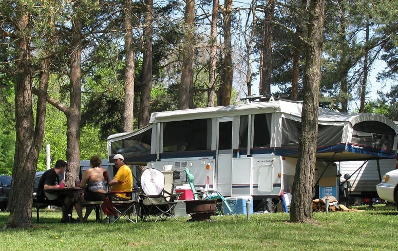 Friends On Camping With Pop Up Tent Trailer