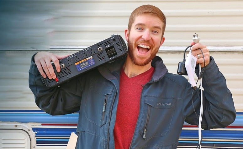 Man Holding Electrical System For RV