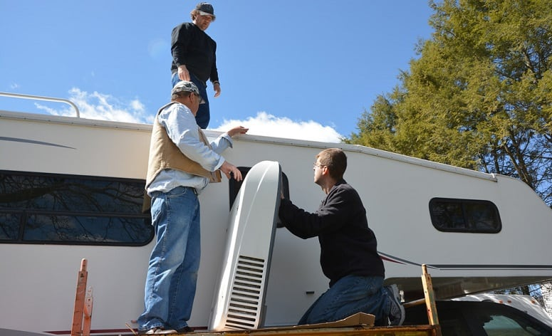 Three Man Installing RV Air Conditioner