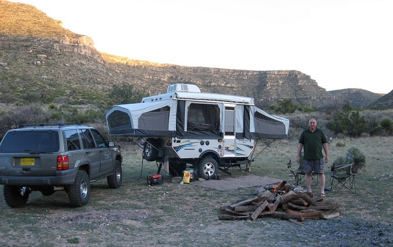 Man With Pop-Up Tent Trailer