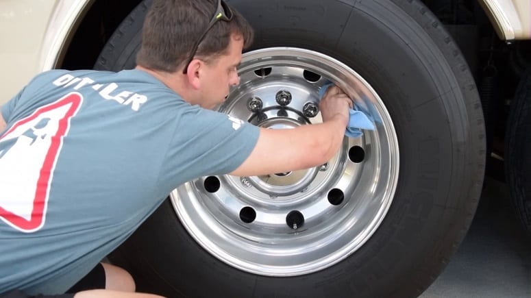 Man Cleaning Tire