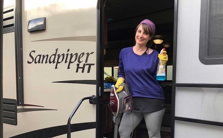 Woman Preparing For Cleaning RV Inside