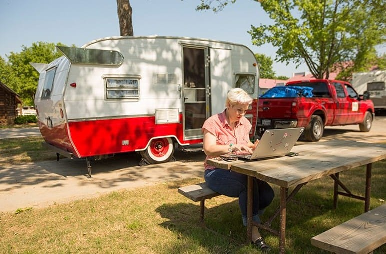 Woman Using Laptop While Camping