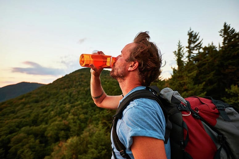 Man Drinking Water On Hiking