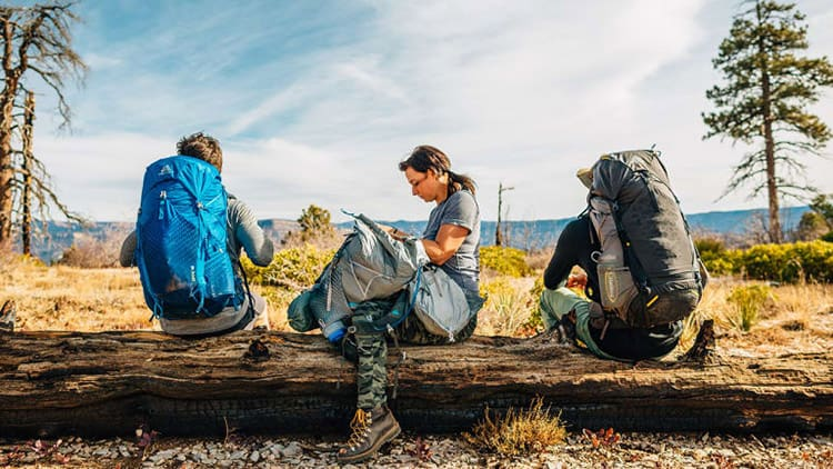 backpackers packing while backpacking