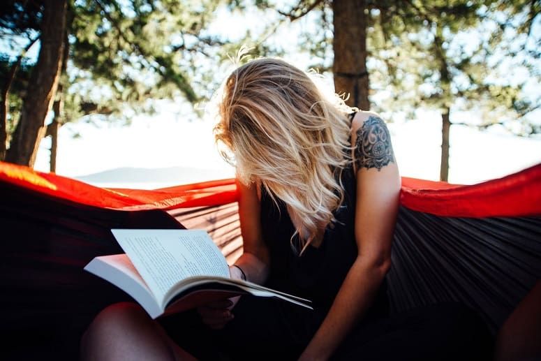 Woman Reading Book On Camping