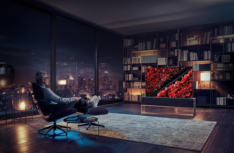 Man Sitting In Chair And Watching TV