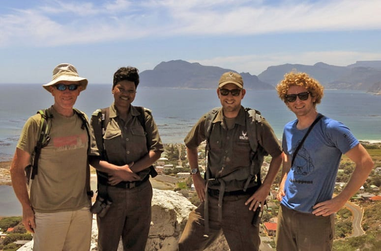 Two Hikers Taking Picture With Park Rangers