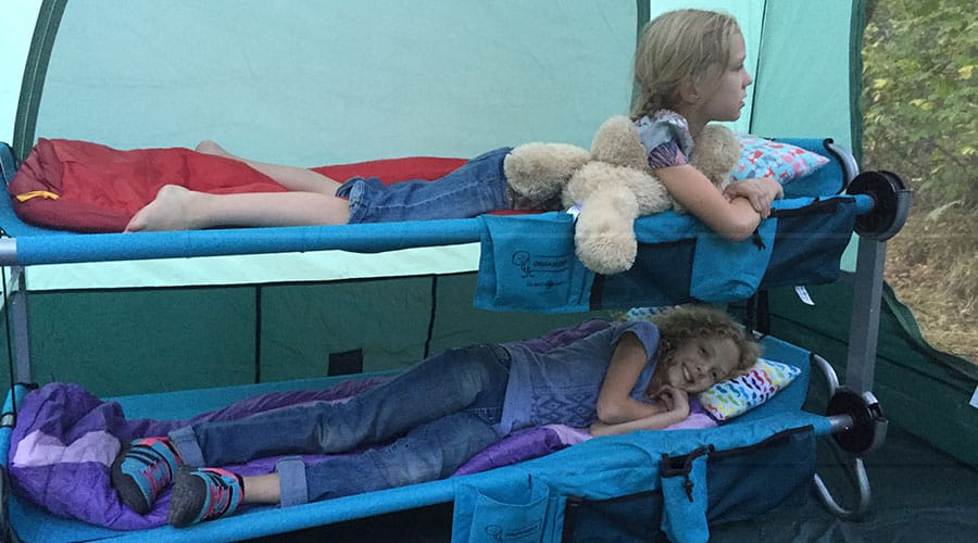 kids in bed while camping