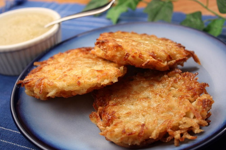 Three Potato Pancakes On Plate